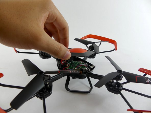 Once all of the screws are off, lift off the top of the drone.