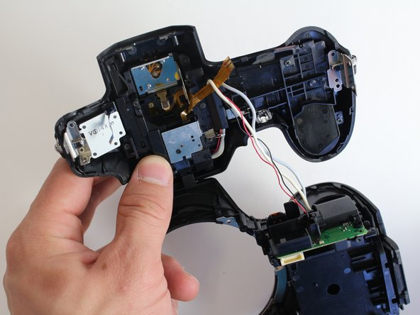 Do not yank off the top panel of the camera. If you do, you will snap the electric wires that attach the panel to the battery housing.