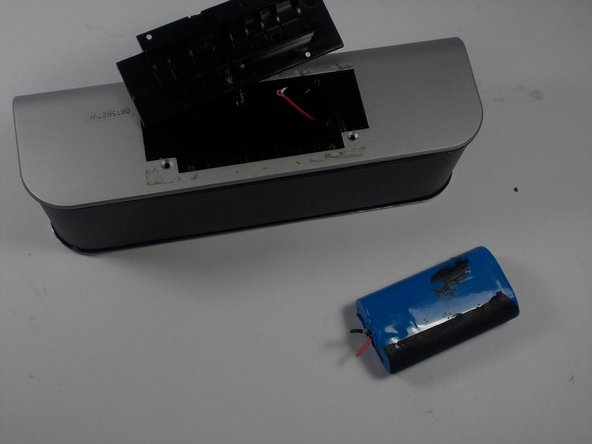 To remove battery, cut the wires that connect to the battery.