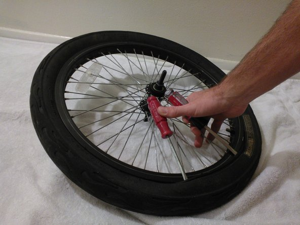 Use a second screwdriver and repeat step 3 to create a four to six inch lip where the tire overlaps the rim.