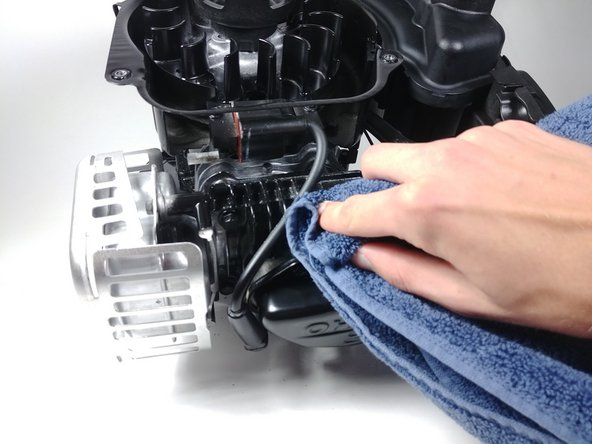 Using compressed air and a rag, clean the heat sink.