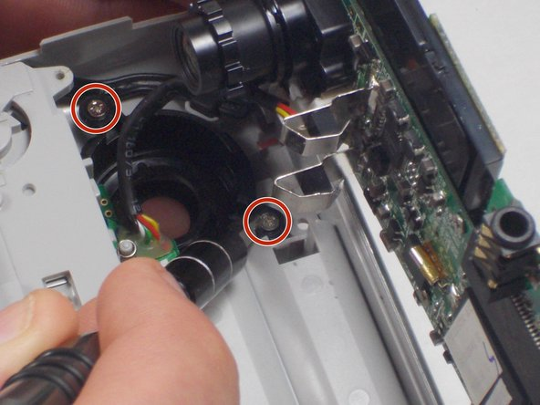 Unscrew the 2 1mm screws and gently separate camera wires from plastic casing.