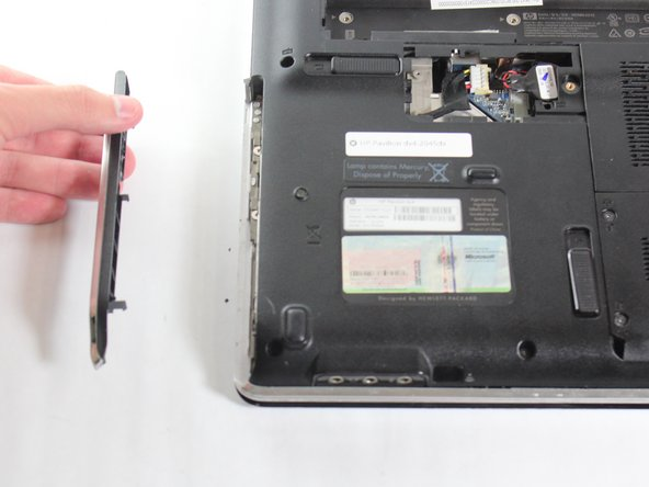 Remove the optical drive control panel with a thin flat tool