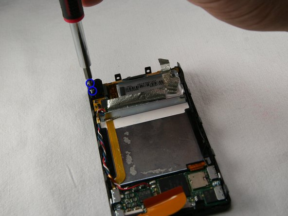 Remove the two T4 screws holding the headphone jack receiver on the top left corner of the device.