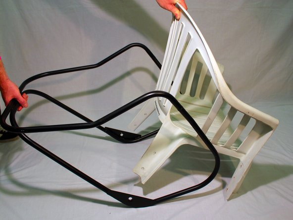 Fit the lawn chair with the main frame by aligning the back of the lawn chair with the frame