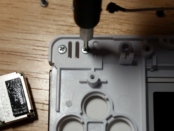 This is the chief design flaw of the Nintendo DS Lite. The latch assembly is much too fragile. Save the screws and the metal and plastic piece if you're replacing the shell.