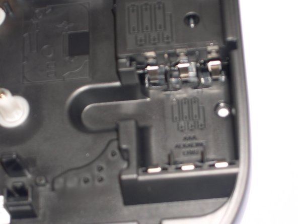 Image 2/3: If your using an AC adapter or both batteries/AC adapter, make sure the AC adapter is plugged into the AC outlet. Then place correctly and push in fully to plug-in on top corner on device. Also, check that your batteries are place in correctly, if using both.
