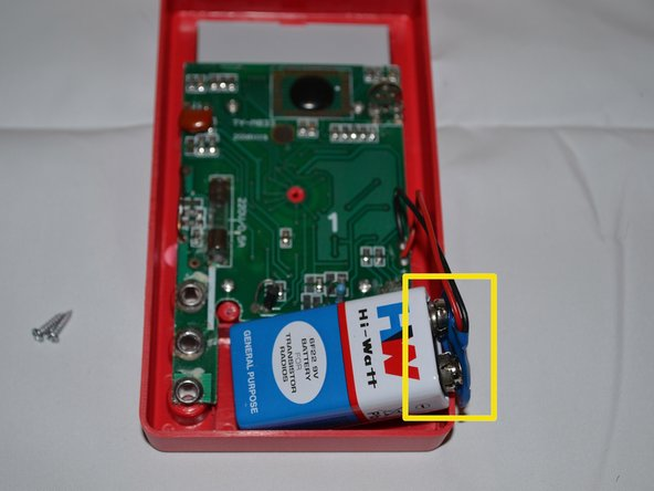 After removing the outer casing and motherboard of the device, locate the attachment site of the battery to the motherboard.
