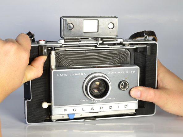 Image 1/3: Remove the camera cover in order to make the camera easier to work with.