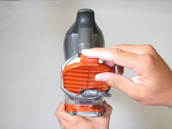 Remove the motor filter lid by  pushing the release clip on the top and pulling towards you.