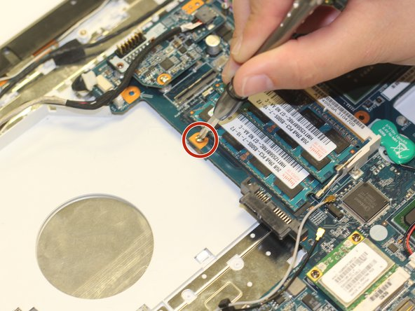 Using the Phillips #00 screwdriver, remove the one 3.7 mm screw that secures the keyboard to the laptop.