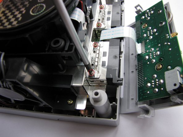 Then remove the heatsinks of the memory card slots (necessary step).