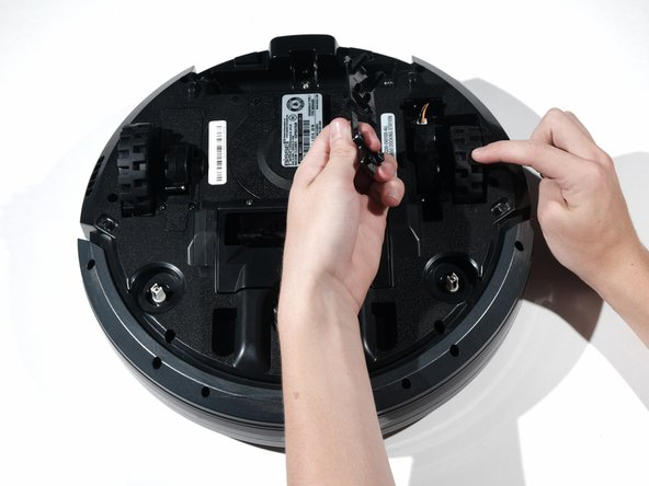 Remove the spring and carefully pull the wires out to disconnect the wheel from the socket.
