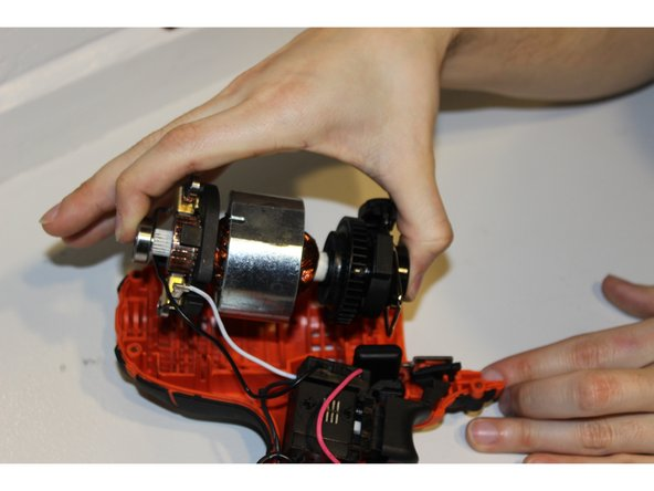 Gently pull up the motor and other components at the top of the device except the handle.