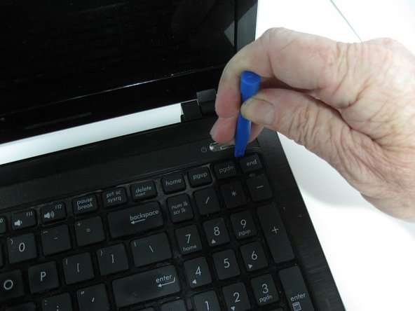 Use your hand to gently pull the keyboard away from the laptop.