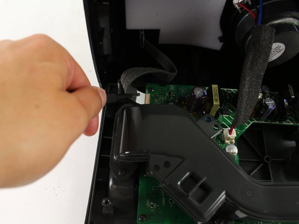 Use ESD Safe Tweezers (Blunt Nose) to pull out the wire ribbon at the end of the motherboard.