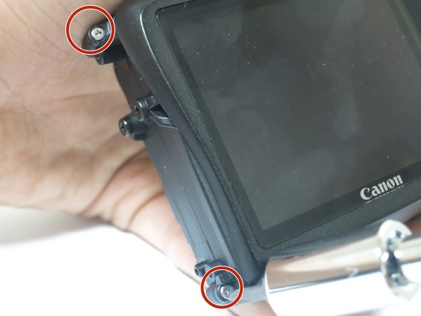 Using the Philips #00 screwdriver, remove the two screws on the left side of the case.