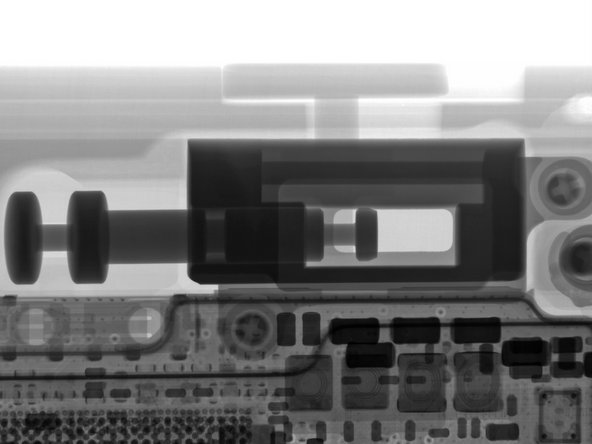 The slider button moves a hefty metal plunger, which flips a mechanical switch soldered to the motherboard. The X-ray image provides an even better view.
