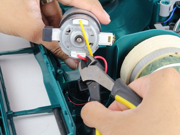 Cut wires with cutting pliers to release the motor.