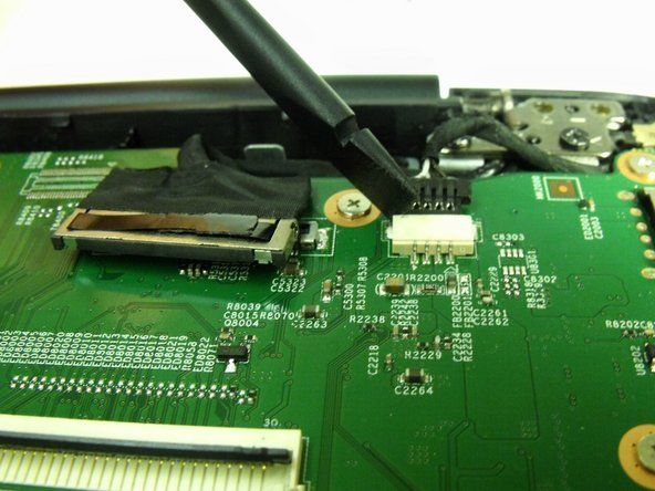 Disconnect the charging port from the motherboard using a spudger to push the 4-wire connector out from the port.
