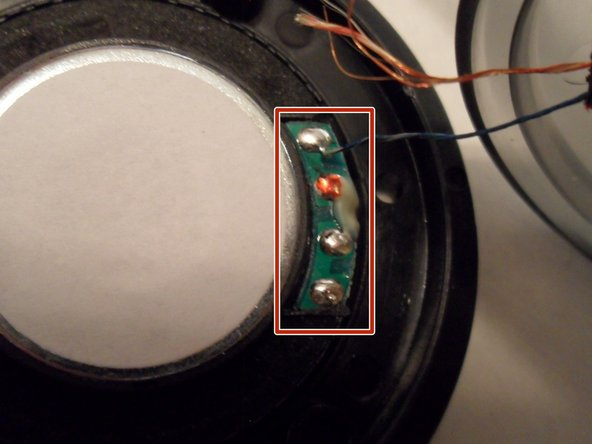 Find the wires connected to the speaker and check if they are intact.