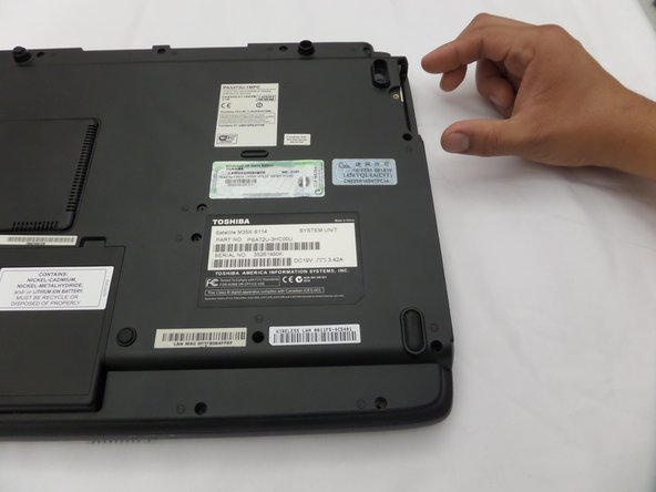 Image 1/2: Slide the hard drive out.