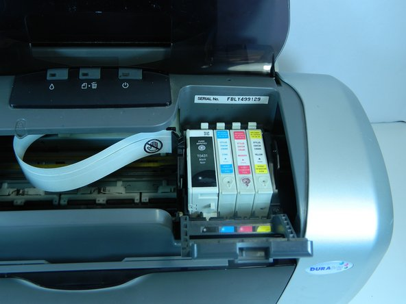 Turn off the printer. The power light should be on, but not flashing. Make sure the output tray is lowered. Then open the printer cover.