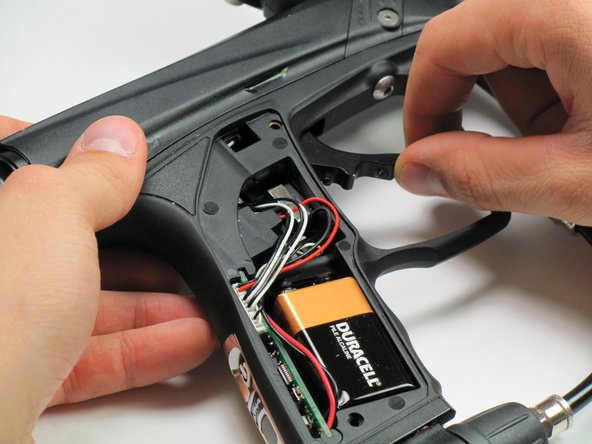 Pull out the trigger by grabbing the bottom and slowly rotating outwards.