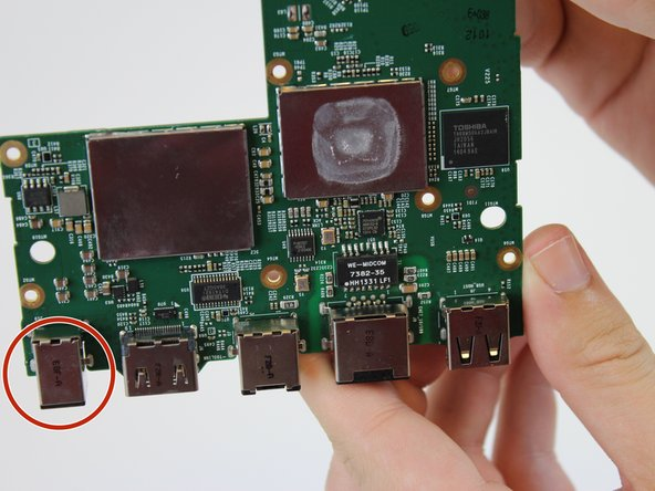 With the mother board back facing you locate the power cord port found on the far left end.