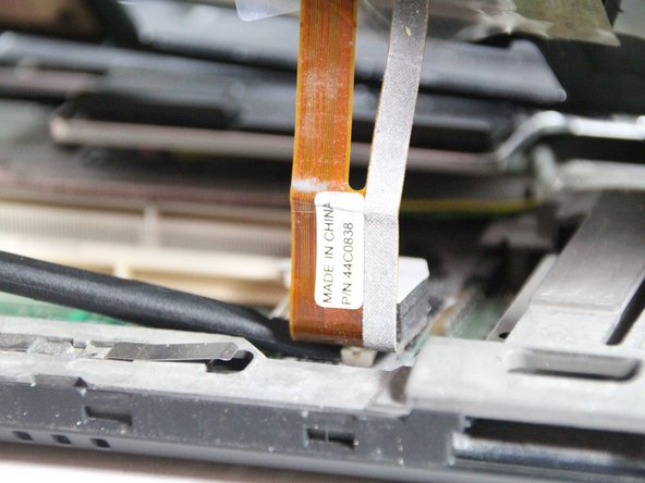 Use the spudger to disconnect the ribbon cable.