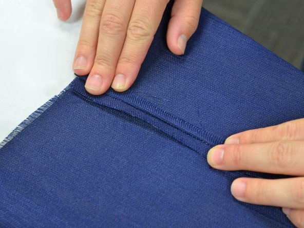 Image 1/3: Take the iron and go directly down onto the seam.