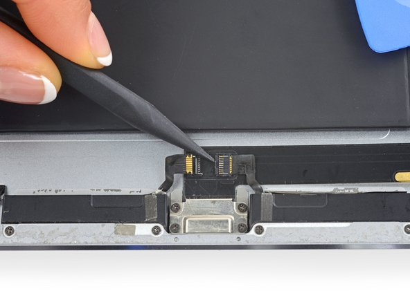 Use a spudger to flip up the retaining flap on the right speaker's ZIF connector.