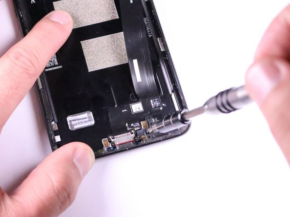 Remove the 0.5mm Phillips screws with a screwdriver by rotating counter clockwise.