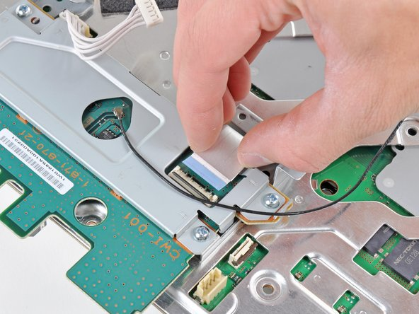 Image 2/2: Pull the Wi-Fi/Bluetooth ribbon cable out of its socket.