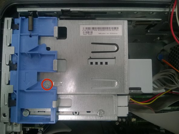 Using a Phillips #1 screwdriver, remove the screw connecting the optical drive to the drive bay.