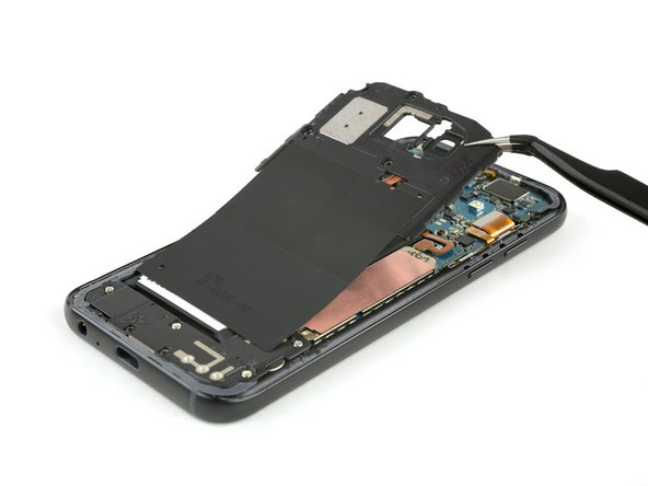 Use a pair of tweezers to lift up the motherboard cover including the loudspeaker and the NFC antenna and remove it.