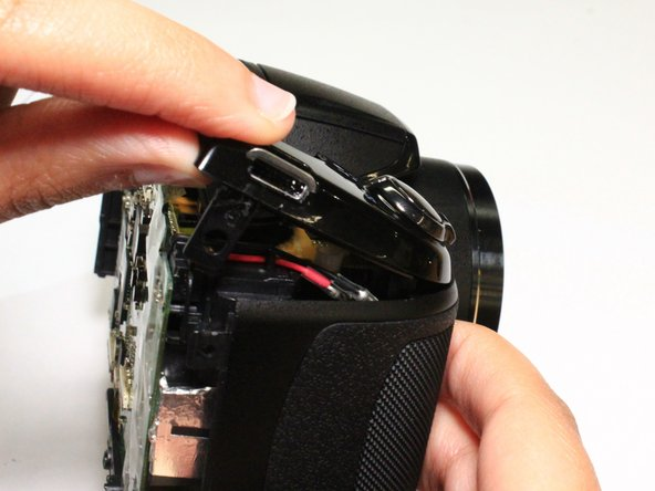 Using a thumb and forefinger, push the plastic cover up until it is at a 45 degree angle.