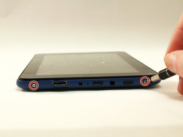 Remove both 4 mm screws on the top of the tablet with a PH00 screw driver.
