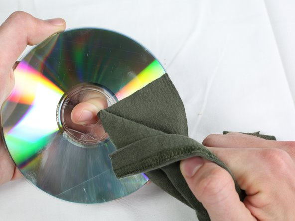 Wipe the CD clean with a new rag, removing any excess compound.