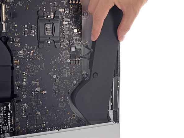 Well, this part of the refresh is less refreshing than we'd like—the right speaker is no longer immediately removable. It's trapped pretty solidly by the new logic board contours.