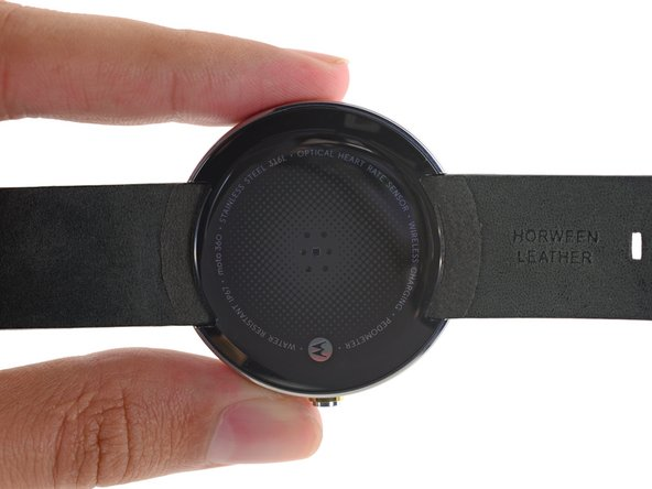 The backside of the Moto 360 is marked with technical specifications in fun holographic text.