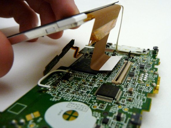 Image 2/3: With both tabs lifted, pull the ribbons off the motherboard and remove the LCD screen.