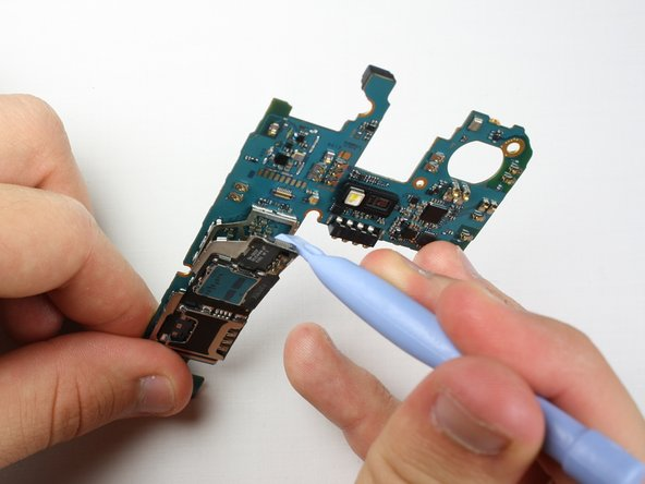 Peel the SIM card assembly away from the motherboard.