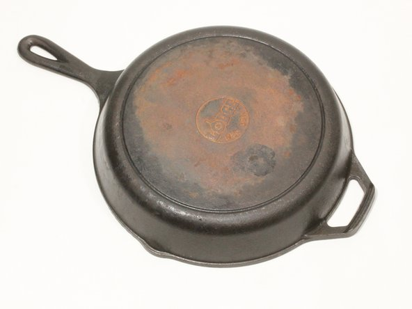 Identify rust spots on the cast iron pan or skillet
