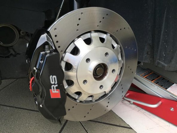 Image 1/2: Install your brake pads and hardware reverse of how you removed.