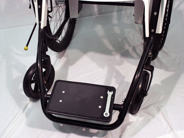 To change the footrest's position, repeat the previous steps but move the footrest bar to the preferred position by lining up the footrest bar with the holes on the sides of the frame
