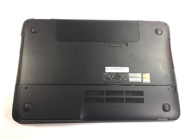 Lay laptop on flat surface with the underside facing up. Unscrew the back panel.