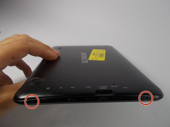 On the top of the tablet there are two 1cm screws that hold the back cover on. Locate these screws and remove them using a Phillips head #0 screw driver.