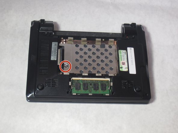 Remove the screw under the hard drive using the Phillips J0 Screwdriver.