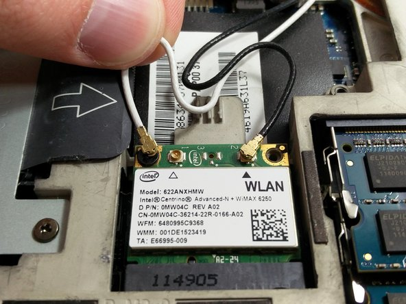 Your Wi-Fi card will have two wires attached and two screws attached. First, gently remove the two wires by pulling up.